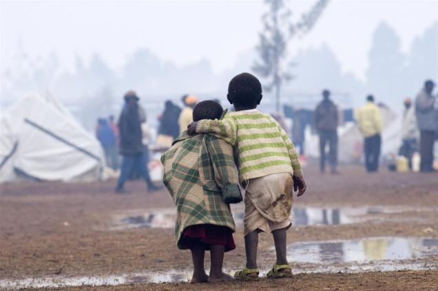 On 2 February, two small children huddle together during a rain storm at a temporary camp where 18,000 people, displaced by the post-election violence, have sought refuge, in the town of Eldoret, in Rift Valley Province. In January and February 2008 in Kenya, the violence and ethnic attacks that began after the disputed presidential election in late December 2007 continue throughout the western provinces, particularly in the Rift Valley, and in Nairobi, the capital. An estimated 1,000 people have been killed. The violence has caused the displacement of some 300,000 – at least half are children and more than 80,000 are under age five. The current situation is widely acknowledged as the worst humanitarian emergency in Kenya's history. Many of the displaced are staying in makeshift shelters and there have also been incidences of sexual and other physical violence against children and women. UNICEF is working with Government ministries, the Kenya Red Cross and other partners in the areas of water, sanitation and hygiene, health, nutrition, education and protection. Ninety per cent of children under age five currently in camps for the displaced are receiving UNICEF-provided supplementary food. UNICEF is also providing more than 15,000 children affected by the conflict with educational facilities, tents and learning and recreational materials.
